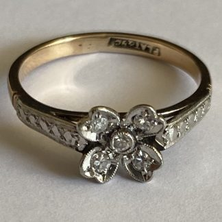 platinum and gold diamond flower ring
