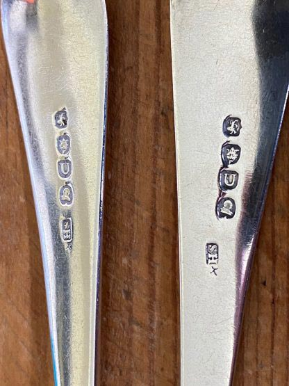 pair of silver serving spoons